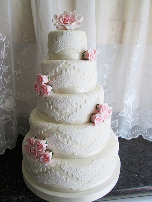 5 tier wedding cake with cascading flowers 5 tier wedding cakes classic cakes sugar fresh flowers 10476