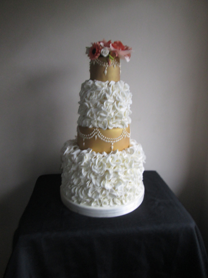 4 Tier gold and ivory ruffle cake £390.00
